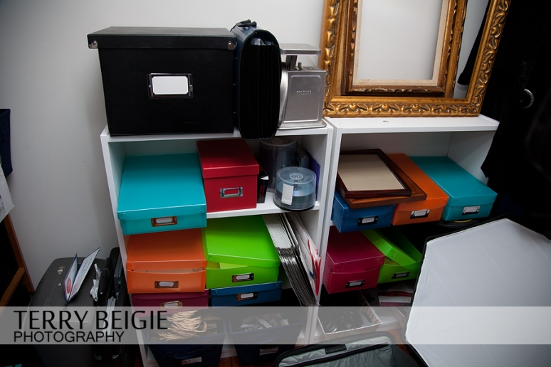 I have all my contracts in this black box, and other items in the other colorful boxes. Also, there is my cover for the strobe. I keep it like that because it was difficult to put together!
