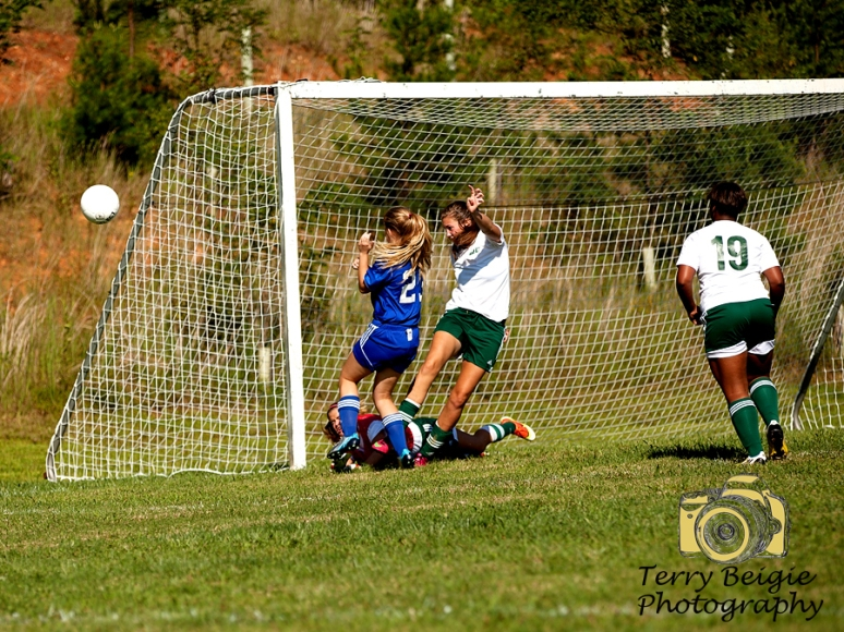 soccer girls goal blocked