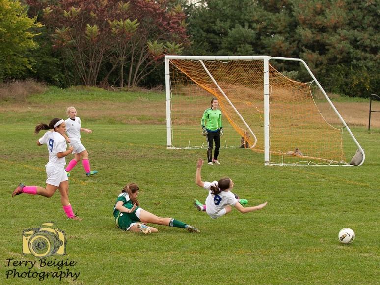 soccer girl slide tackle