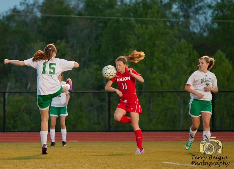 girl soccer ball hit face